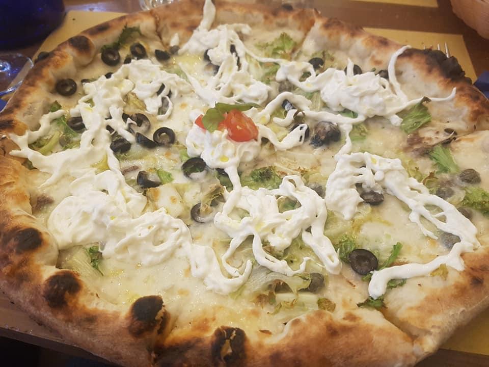 La Pizza del TriticuM è frutto di una lunga lavorazione di farine macinate a pietra