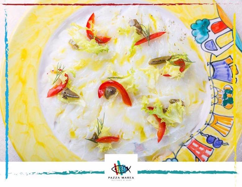 Carpaccio di baccalà con salsa agli agrumi, scarole e papaccelle