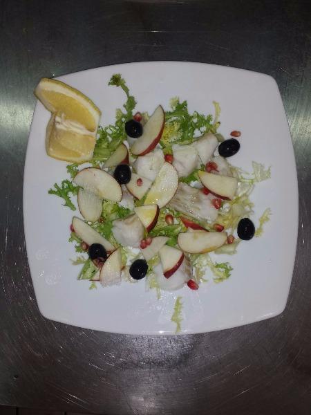 Filetto di baccala con scarola riccia mela annurca  olive taggiasche  e melograno