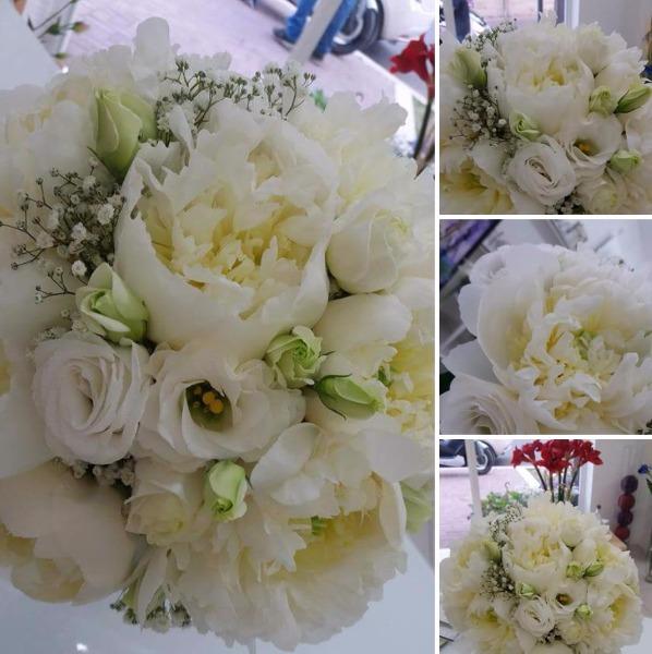 Bouquet tondo sposa con peonie bianche e lisantbus